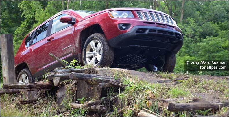 Jeep Compass crossing logs