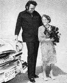 Johnny Cash and Mrs Hild with her 1954 Plymouth Savoy