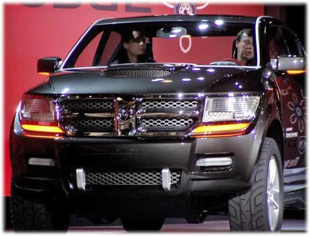 overhead a ladder type front to rear console with storage and entertainment units incorporates mood lighting along its edges this ended up in the 2008 - 2015 Dodge Rampage