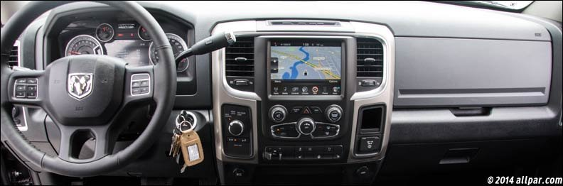 the seats in our test car appeared to have been designed for the larger customer providing good bolsters for a wide person they seemed a bit stiff in the - 2014 Dodge Ram 2500 Tradesman Interior