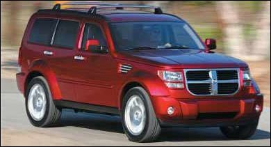 Dodge Nitro SUV. The Rear Of The Vehicle Had Dual Tail Pipes And A Brushed  Silver License Plate Visor; The Roof Had A Silver And Black Roof Rack And  ...