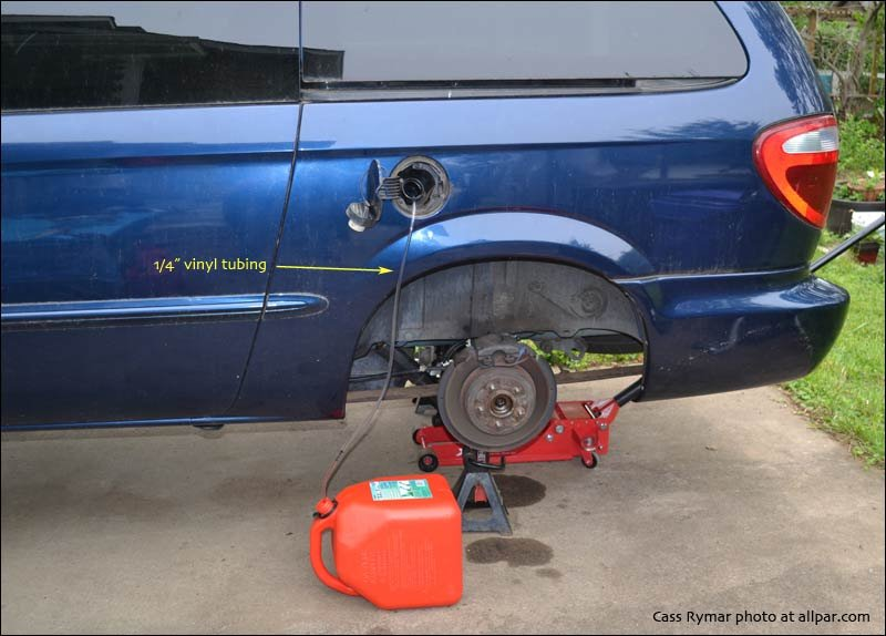 drain the fuel tank (it's easier after the vehicle has been jacked up)  use  1/4